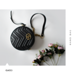 gucci marmort round hand bag.png